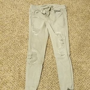 Green skinny jeans with holes